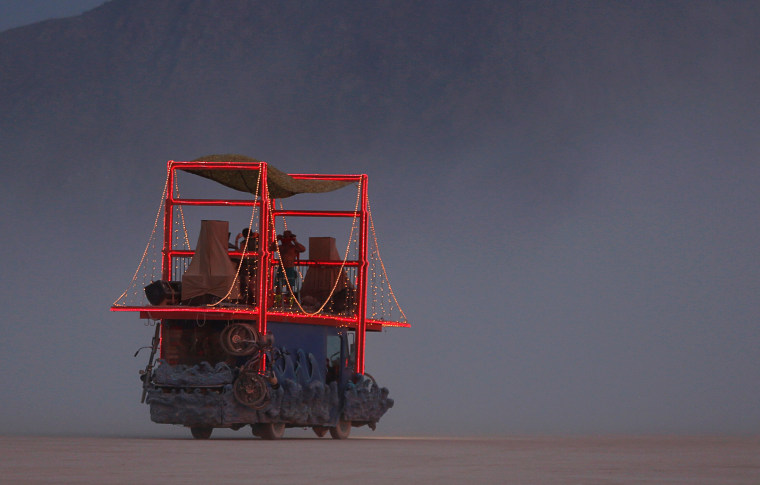 Image: A mutant vehicle on the Playa as approximately 70,000 people from all over the world gather for the 30th annual Burning Man arts and music festival in the Black Rock Desert of Nevada, U.S.