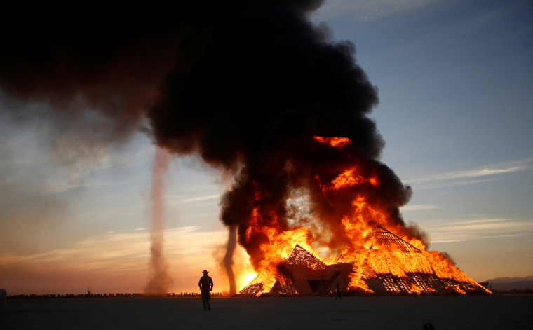 Image: The Catacomb of Veils is burned as approximately 70,000 people from all over the world gather for the 30th annual Burning Man arts and music festival in the Black Rock Desert of Nevada, U.S.