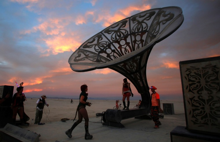 Image: Participants explore the art installation La Victrola as approximately 70,000 people from all over the world gather for the 30th annual Burning Man arts and music festival in the Black Rock Desert of Nevada, U.S.