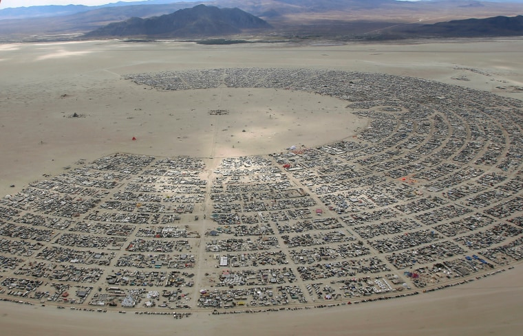 Image: An aerial view as approximately 70,000 people from all over the world gather for the 30th annual Burning Man arts and music festival in the Black Rock Desert of Nevada, U.S.