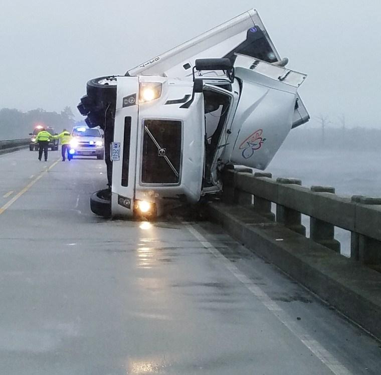 A tractor-trailer overturned on on the Alligator River Bridge in North Carolina.
