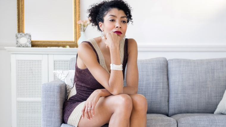 Woman sitting alone on couch