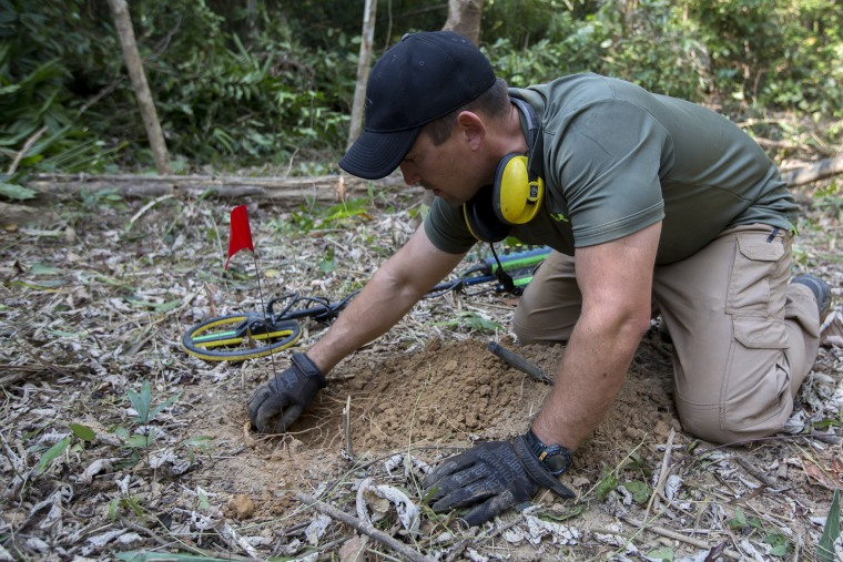 Image: A U.S. Marine searches for UXO near the village of Ban Na Ngom, Savannakhet, Laos