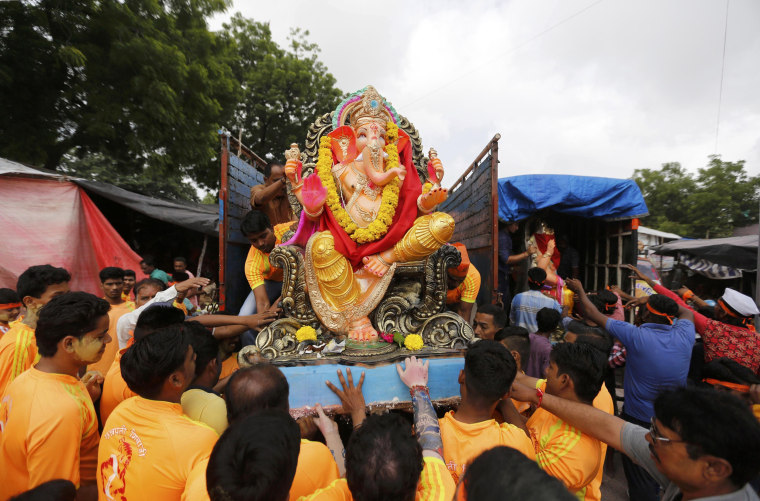 Image: An idol of the Hindu god Ganesh is loaded onto a supply truck on the first day of the Ganesh Chaturthi festival in Ahmedabad