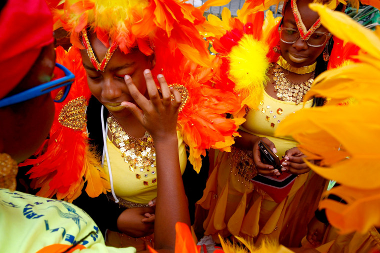 Image: Participants are seen during the West Indian Day Parade in the Brooklyn borough of New York