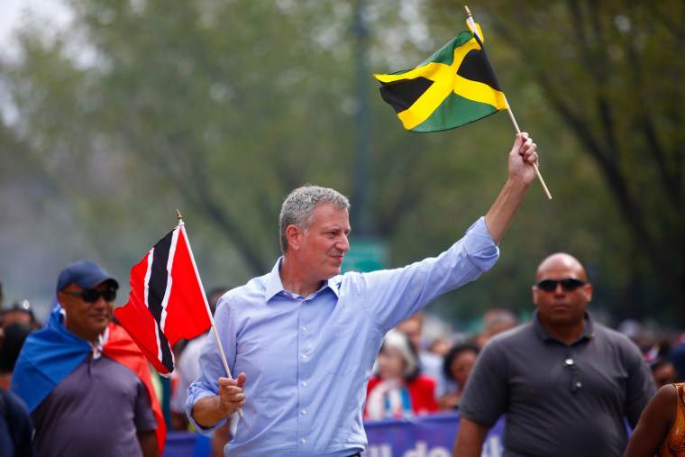 Image: New York Mayor Bill de Blasio marches during the West Indian Day Parade in the Brooklyn borough of New York