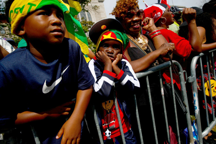 Image: Spectators are seen during the West Indian Day Parade in the Brooklyn borough of New York