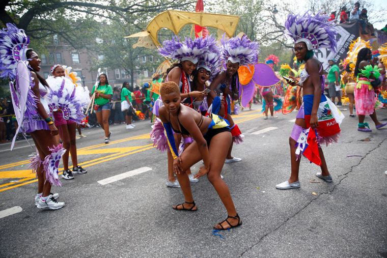 Image: Participants dance during the West Indian Day Parade in the Brooklyn borough of New York