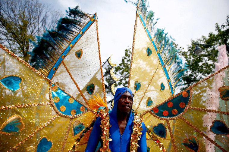 Image: A participant wears a costume during the West Indian Day Parade in the Brooklyn borough of New York
