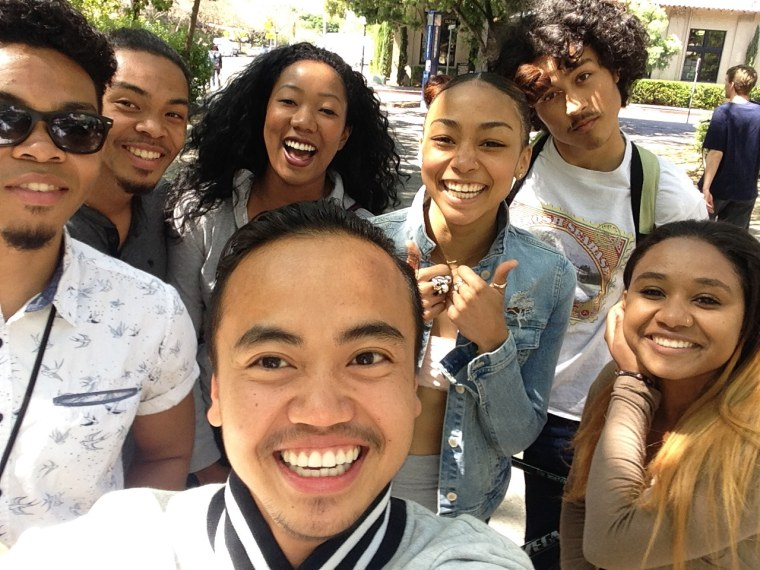 Senmo Omnes, center, with several cast members of the Blasian Narratives project.