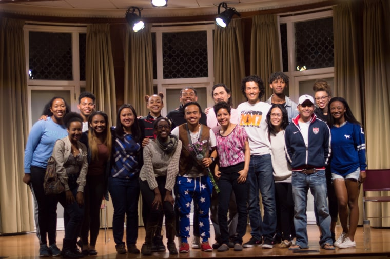 The cast of the Blasian Narratives project poses after a live performance with some members of the audience.