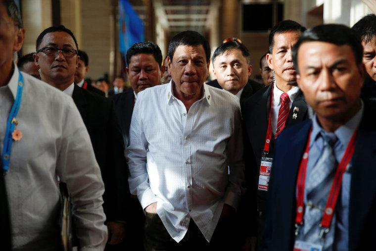 Image: Philippines President Rodrigo Duterte walks between meetings at the ASEAN Summit in Vientiane