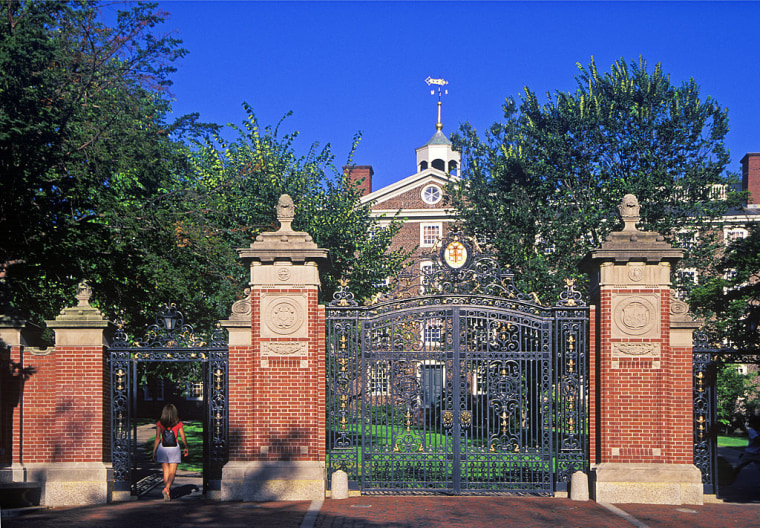 Student enters front gate to Brown University