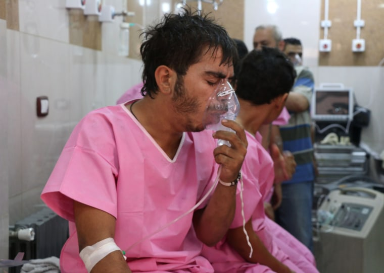 Image: A Syrian man suffering from breathing difficulties is treated at a make-shift hospital in Aleppo, Tuesday.