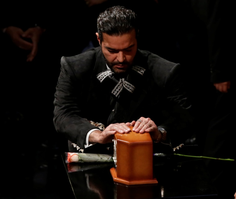 Image: Singer Pablo Montero touches the box containing the ashes ofashes of the late Mexican singer Juan Gabriel during his homage in the Bellas Artes Palace in Mexico City, Mexico