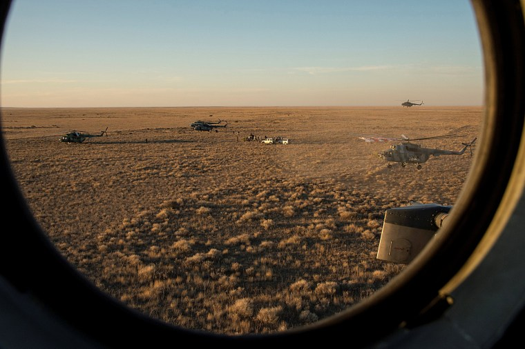 Image: Search and rescue team approaches the Soyuz TMA-20M spacecraft capsule after its landing near the town of Zhezkazgan (Dzhezkazgan), Kazakhstan