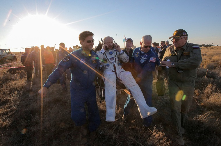 Image: Ground personnel carry the International Space Station (ISS) crew member Jeff Williams of the U.S. after landing near the town of Zhezkazgan (Dzhezkazgan), Kazakhstan