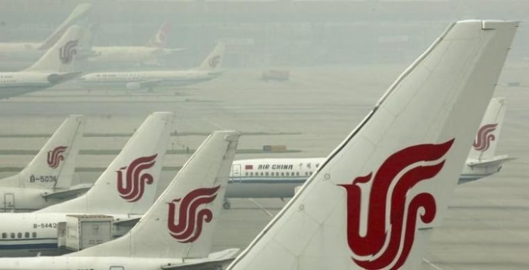 Air China planes are seen on the tarmac of the Beijing Capital International Airport