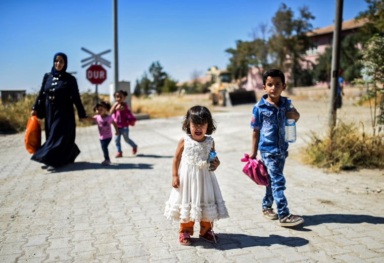 Image: TOPSHOT-TURKEY-SYRIA-ARMY-REFUGEES