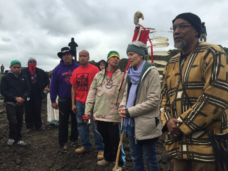In this photo provided by LaDonna Allard, Green Party presidential candidate Jill Stein, second from right, participates in an oil pipeline protest, Tuesday, Sept. 6, 2016 in Morton County, North Dakota