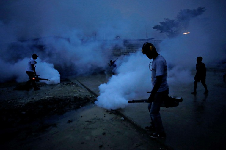 Image: Workers of the Ministry of Public Health and Population fumigate in the street against mosquito breeding to prevent diseases such as malaria, dengue and Zika, during a fumigation campaign in Port-au-Prince, Haiti