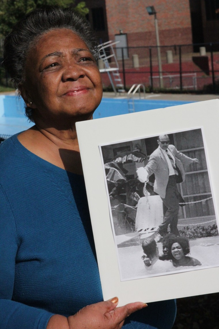 Mimi Jones of Boston holds a historic photo of her at age 17 that circled the globe during the height of the Civil Rights Movement.