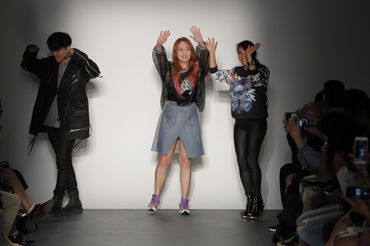 Yohan Kim, Heejim Kim, and Younhee Park following the Concept Korea show at New York Fashion Week