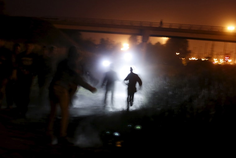 Image: Migrants attempt to access the Channel Tunnel