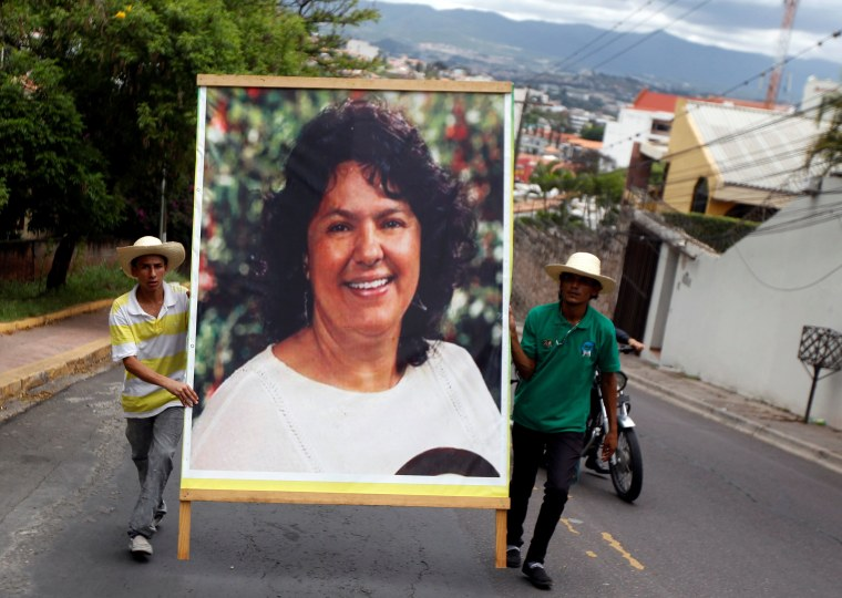 Image: Farmers carry a banner with an image of slain environmental rights activist Berta Caceres during a protest to demand justice for her death in Tegucigalpa, Honduras