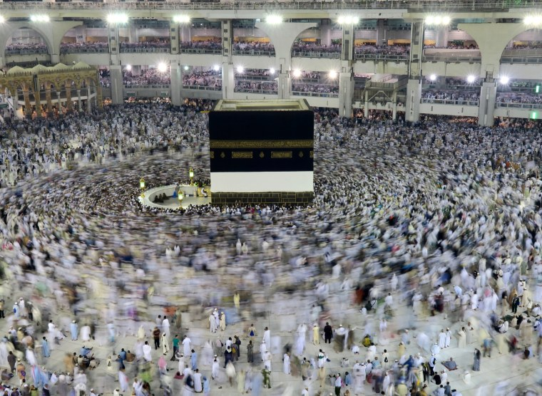 Image: Muslim pilgrims circle the Kaaba at the Grand mosque in Mecca
