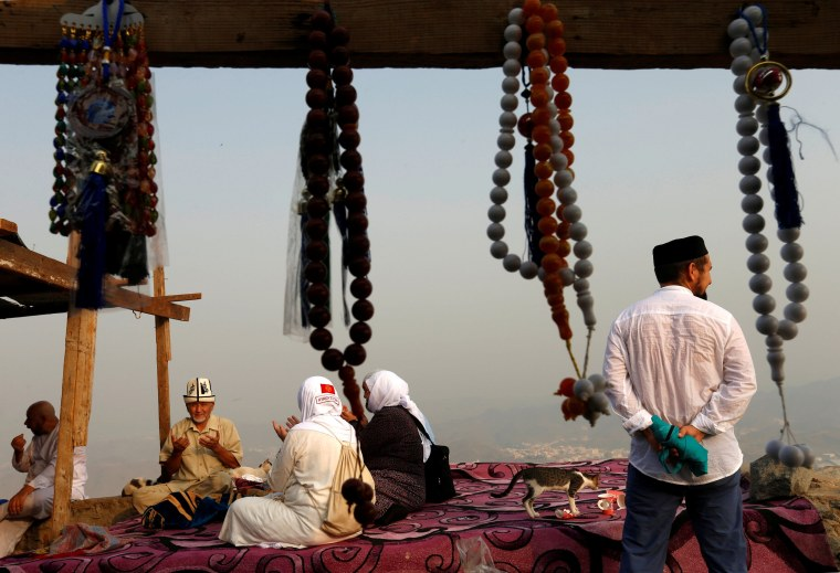 Image: Pilgrims pray at Mount Al-Noor ahead of the annual haj pilgrimage in the holy city of Mecca