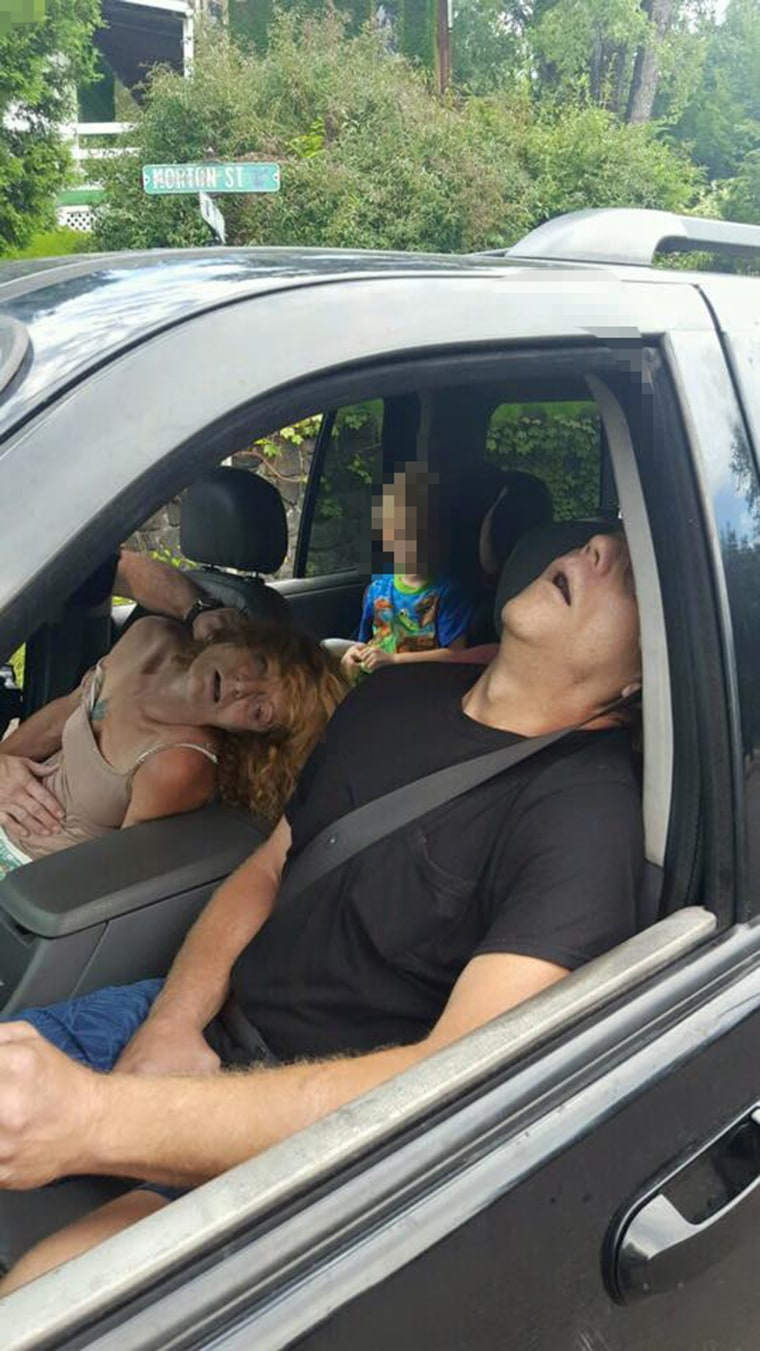 East Liverpool Police Department posted a photograph on the departments Facebook page of a couple overdosing on heroin in an SUV while a 4-year-old looks on from the back seat.