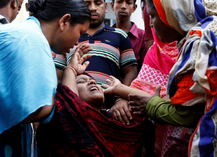 Image: A woman mourns at a hospital after a fire broke out at a packaging factory outside Dhaka