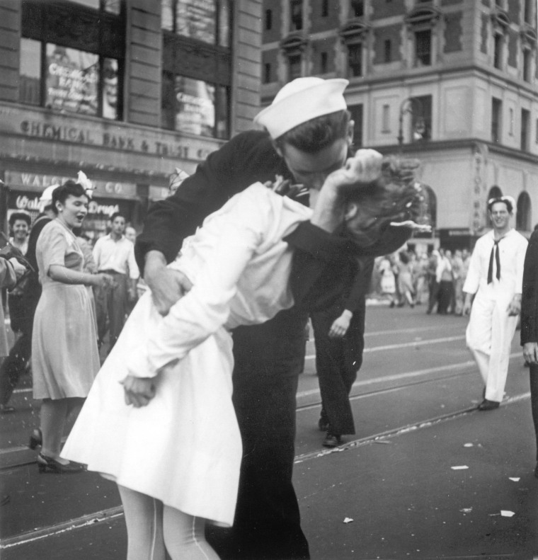 In this photo provided by the U.S. Navy, a sailor and a nurse kiss passionately in Manhattan's Times Square, as New York City celebrates the end of World War II, on August 14, 1945.