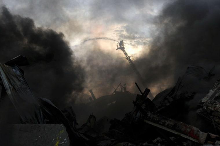 Image: TOPSHOT-BANGLADESH-FIRE-LABOUR