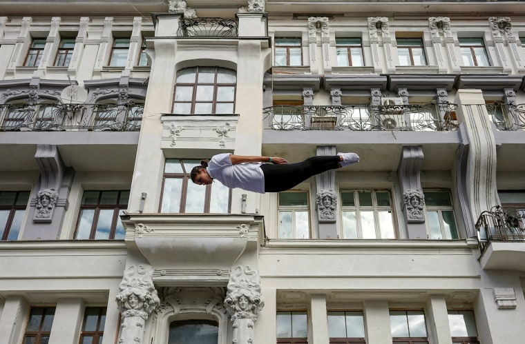 Image: A gymnast performs on a street during the celebrations for the City Day in Moscow