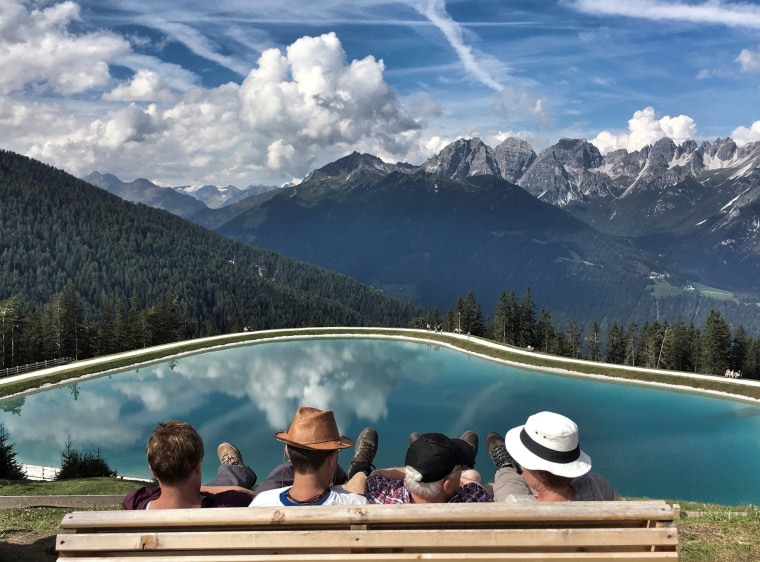 Image: People enjoy the view from Serles mountain on a sunny autumn day in the western Austrian village of Mieders