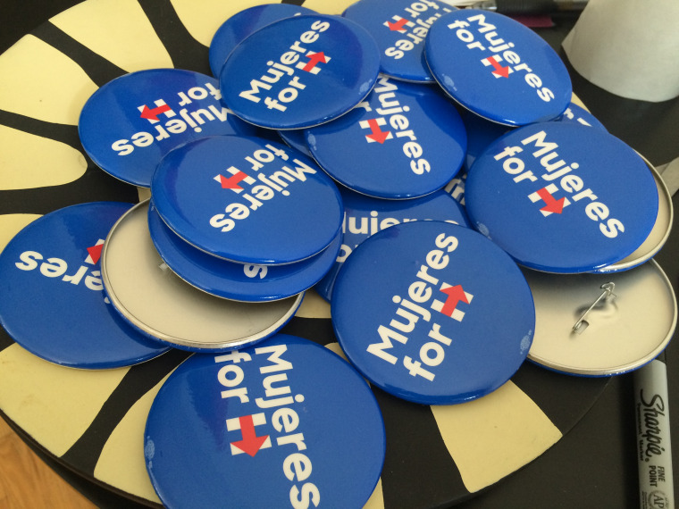 A bowlful of Mujeres for Hillary button are part of a campaign to get Latinas to turn out other Latinas to vote.