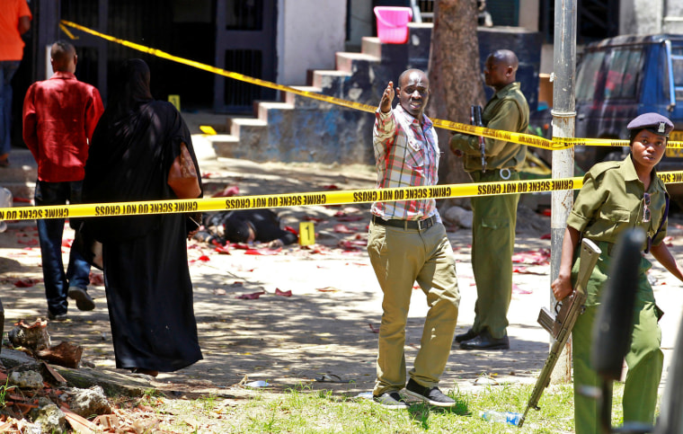 Image: Police officers and explosive experts secure the central police station after an attack, in the coastal city of Mombasa