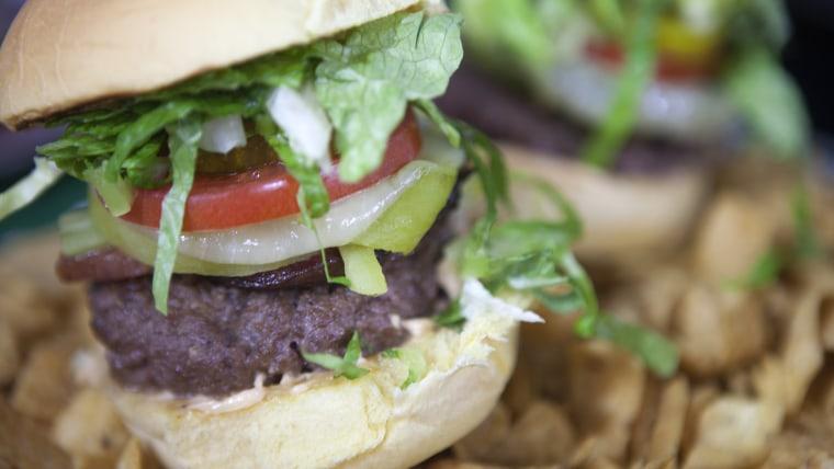 """Chef Hosea Rosenberg makes a """"Bronco Burger"""""""