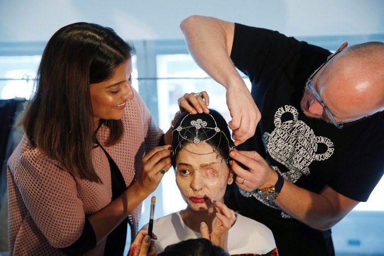 Image: Indian model and acid attack survivor Reshma Quereshi has make up applied before walking to present Indian designer Archana Kochhar's Spring/Summer 2017 collections during New York Fashion Week in the Manhattan borough of New York
