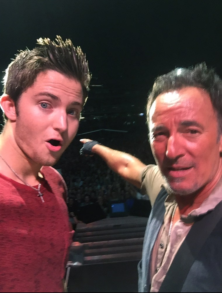 """Matthew Aucoin and Bruce Springsteen on stage after their duet to """"No Surrender."""""""