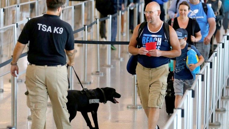 TSA security officer and dog