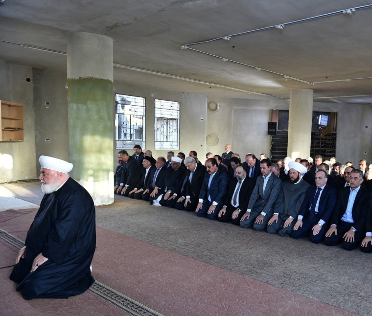 Image: Syria's president Bashar al-Assad, prays at a mosque in a Damascus suburb of Daraya