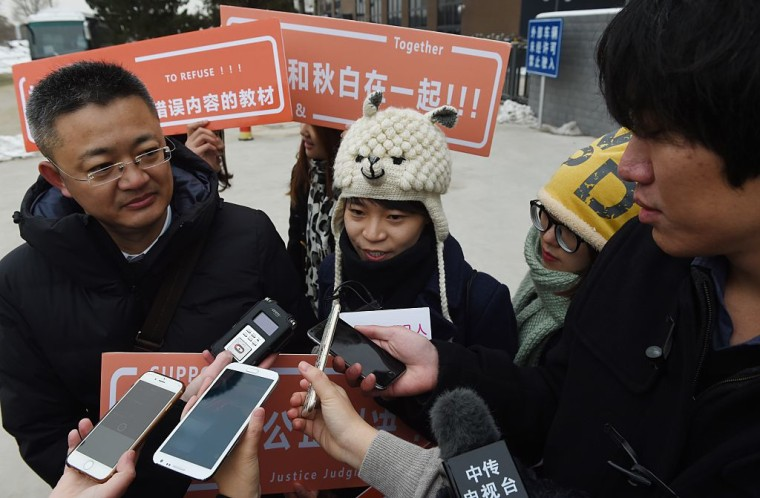 "A Chinese lesbian (center), who goes by the pseudonym Qiu Bai, took the government to court over textbooks describing homosexuality as a ""psychological disorder"", a landmark case in a country where discrimination remains common."