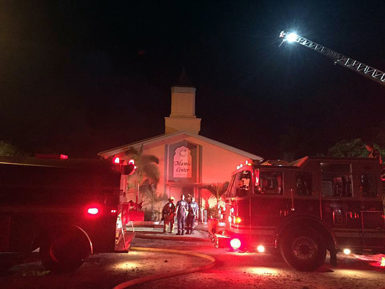Firefighters work at the scene of a fire at the Islamic Center of Fort Pierce, Florida, early on Sept. 12.