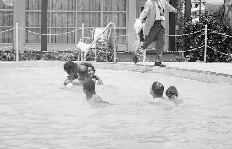 """When a group of white and African American integrationists entered a segregated hotel pool, manager James Brock poured acid into it, shouting """"I'm cleaning pool,"""" on June 18, 1964, St. Augustine, Fla."""