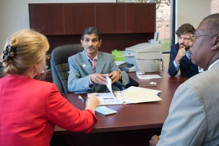 Ramzan Virani meets with community leaders and government officials to discuss the South Asian Public Library.