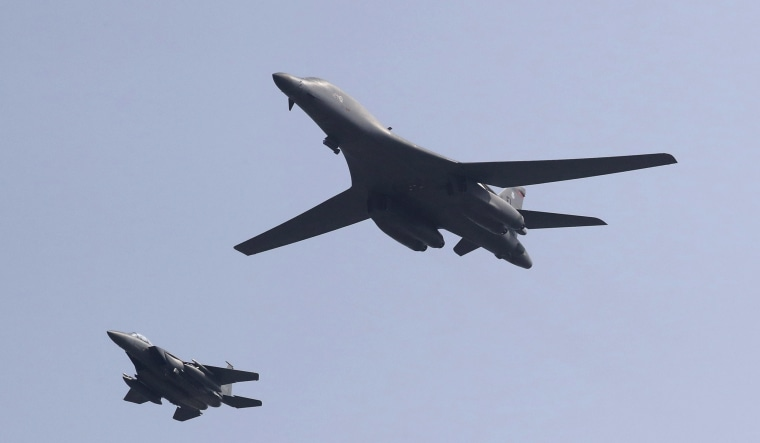 Image: U.S. B-1B bomber, right,  flies over Osan Air Base with South Korean Air Forces jet in Pyeongtaek, South Korea