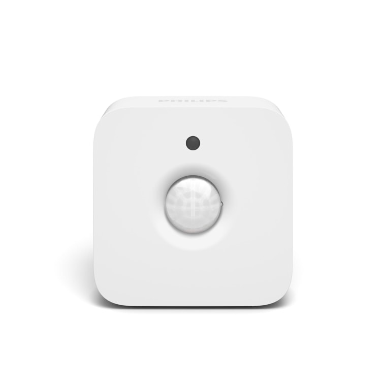 The Philips Hue freestanding motion sensor controls Hue connected lights and can sit on a bookshelf or table, or be mounted to a wall.